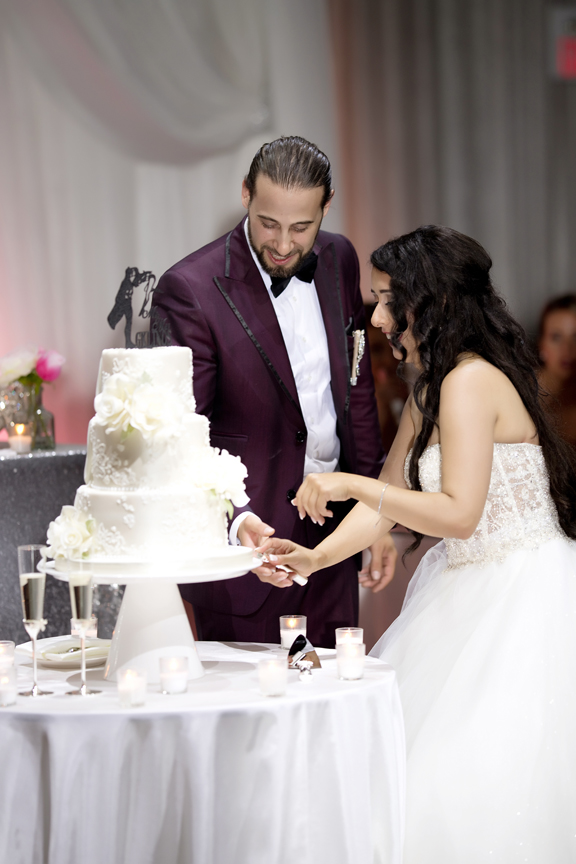 cake cutting Greek and Albanian wedding reception at Grand Luxe Event Boutique