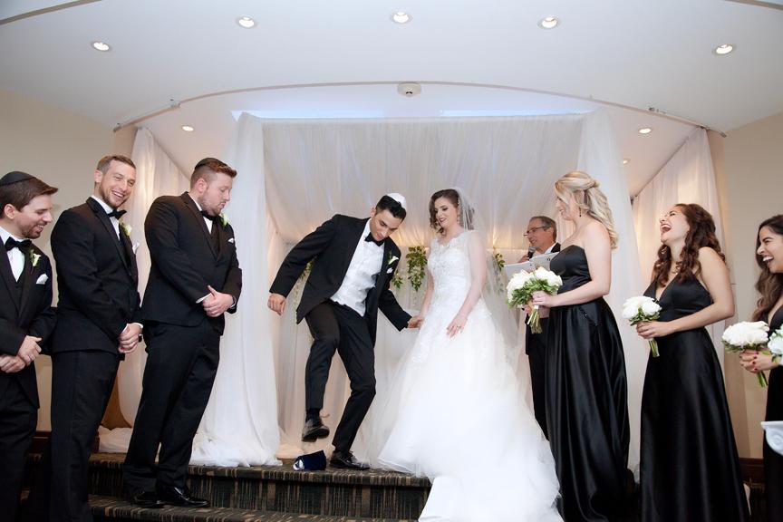 breaking glass Jewish wedding ceremony at Eglinton Grand