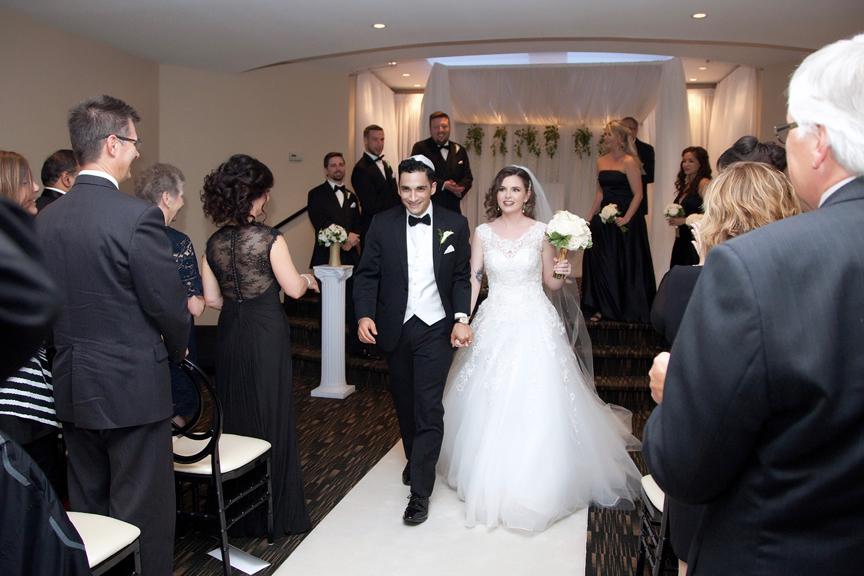 recession Jewish wedding ceremony at Eglinton Grand