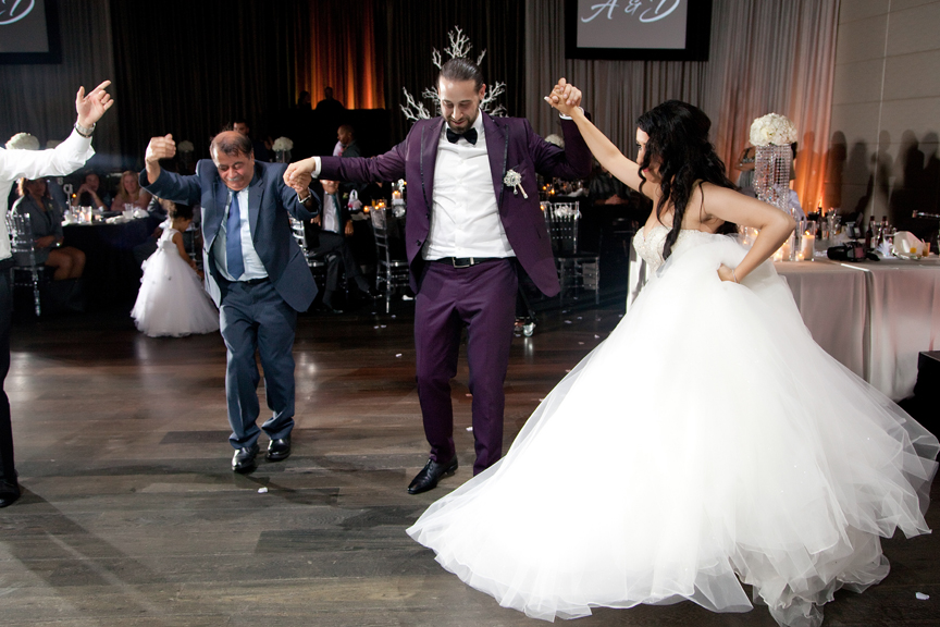 bride and groom dancing with family Greek and Albanian wedding reception at Grand Luxe Event Boutique