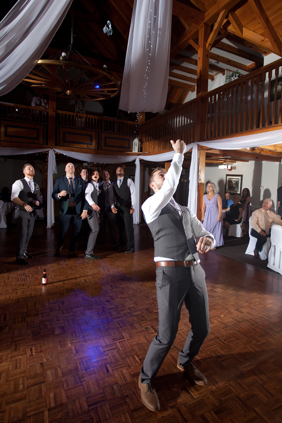 garter toss wedding reception at Trillium Trails Banquet Centre