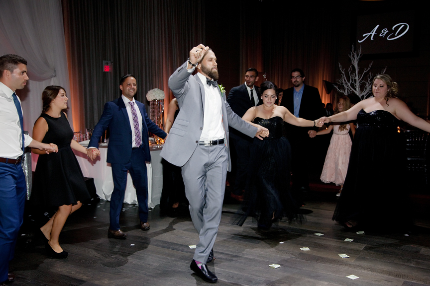 best man dancing Greek and Albanian wedding reception at Grand Luxe Event Boutique