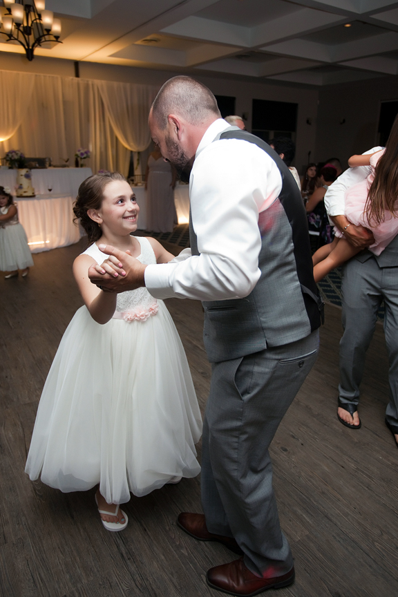 wedding reception groom dancing with daughter