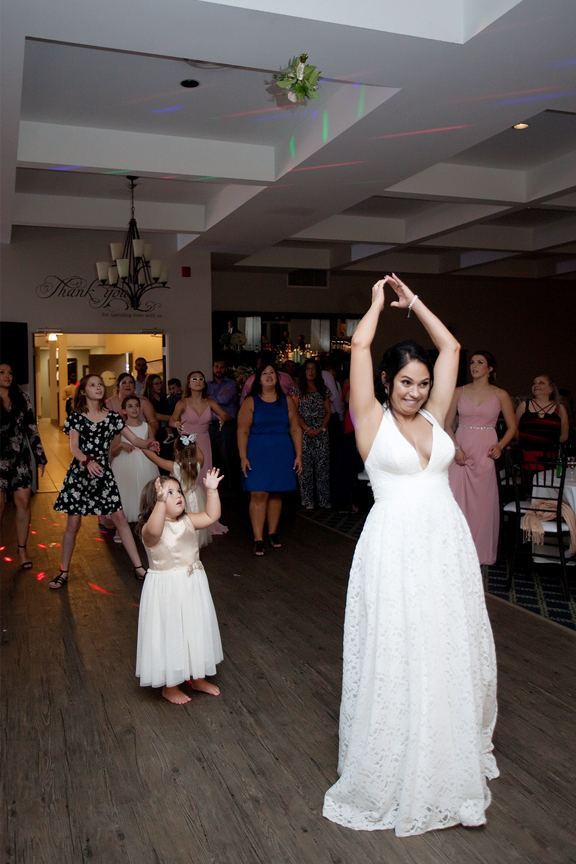 wedding reception bouquet toss
