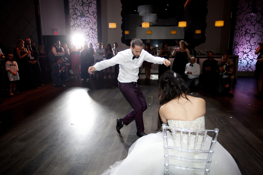 groom dancing Greek and Albanian wedding reception at Grand Luxe Event Boutique