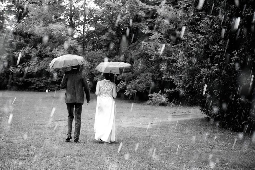 wedding couple in the rain at Ganaraska Forest Centre