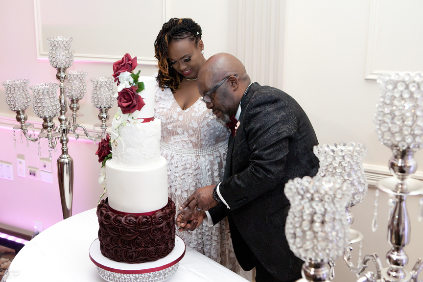 cake cutting wedding reception at Claireport Place