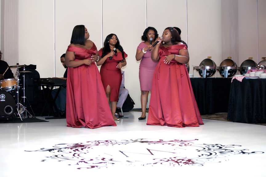 bridesmaids singing wedding reception at Claireport Place