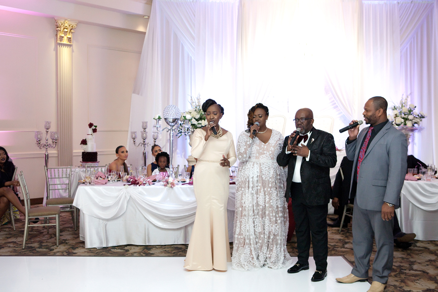 bridal party singing wedding reception at Claireport Place