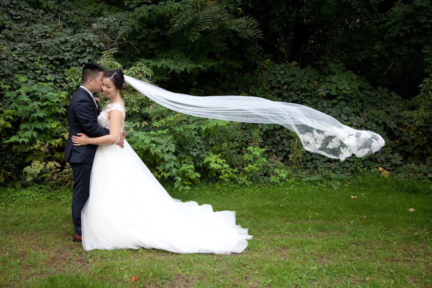 couple flying wedding veil Chinese at Ascott Parc