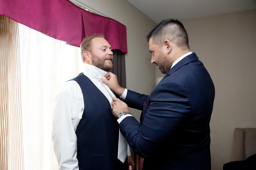 groom prep wedding tie