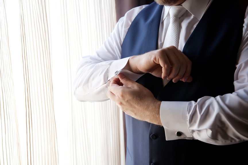 groom prep wedding getting dressed