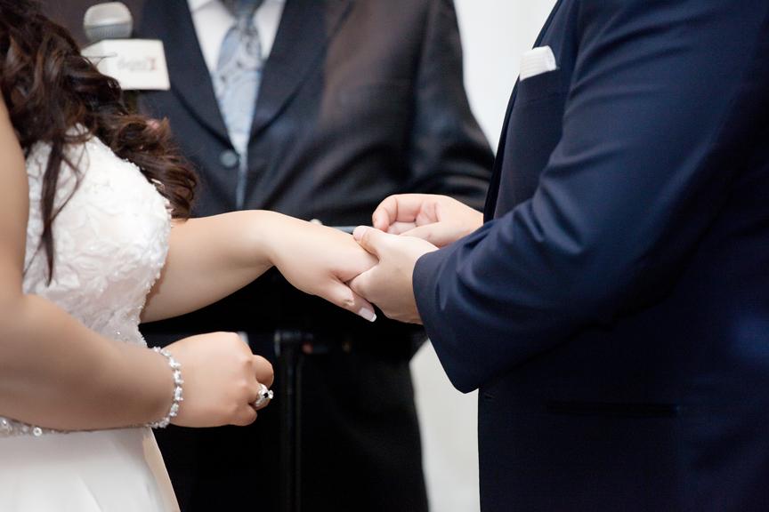 ring exchange wedding ceremony at Venetian Banquet Hall