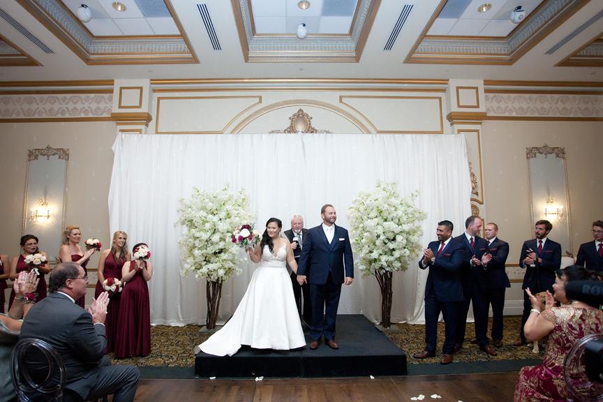 exit wedding ceremony at Venetian Banquet Hall
