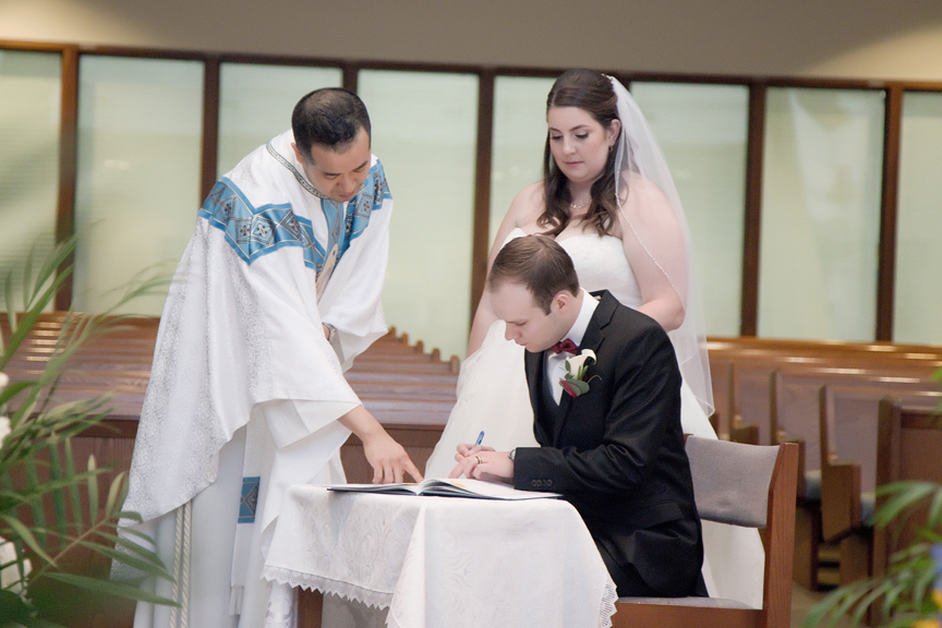 signing marriage document wedding ceremony St Joseph the Worker Parish