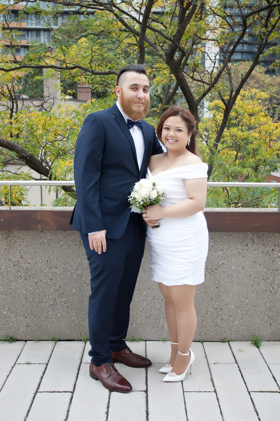 married couple at Toronto City Hall rooftop