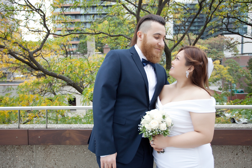 bride and groom at Toronto City Hall rooftop