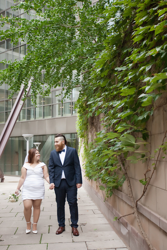 married couple walking at Trinity Square