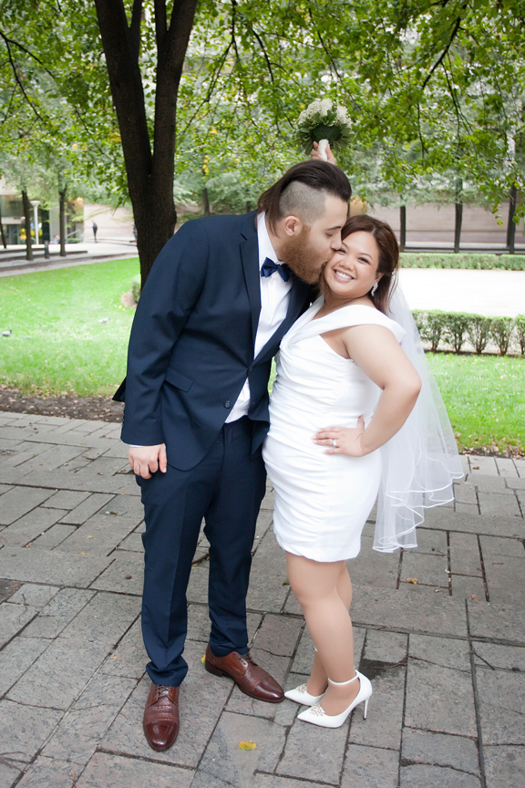 happy married couple at Trinity Square