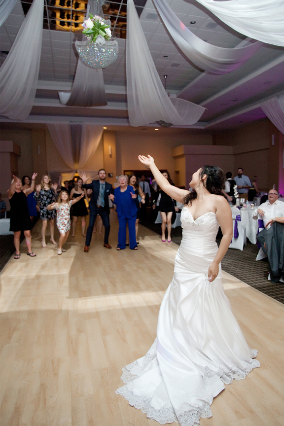 bouquet toss wedding reception at Trinity Banquet Hall