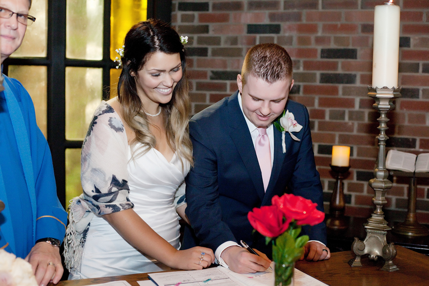 signing marriage document wedding ceremony at Old Mill Toronto