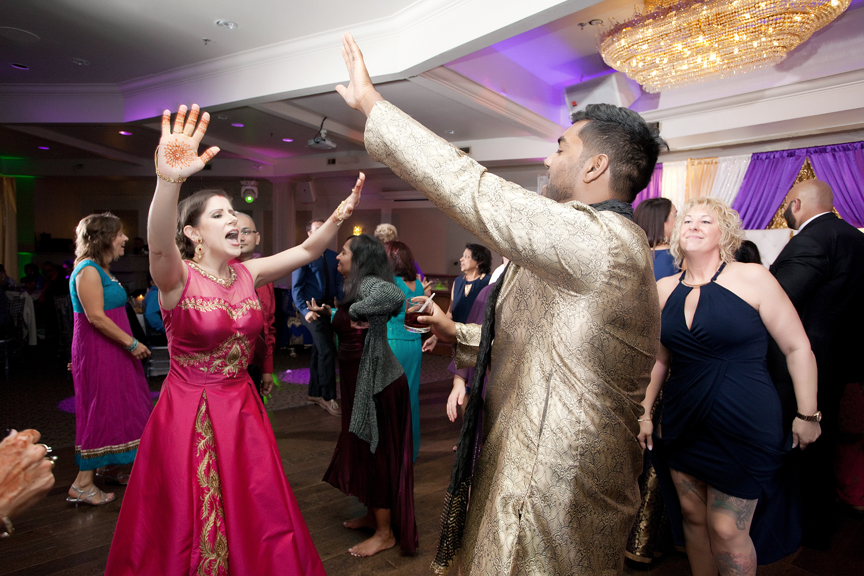 bride and groom dancing Indian wedding reception at Bombay Palace