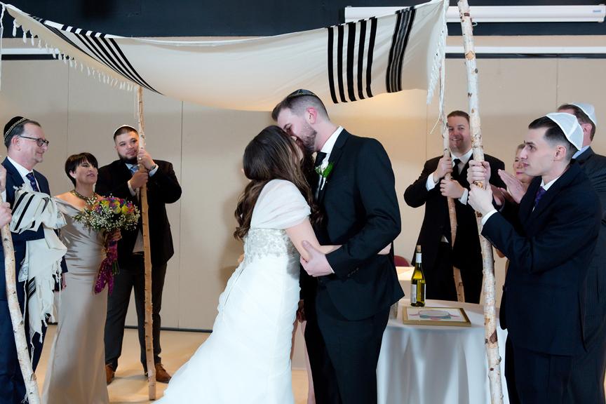 Columbus Centre Jewish wedding ceremony first kiss