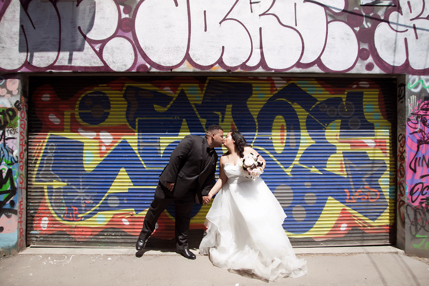 bride and groom kissing wedding portrait at Graffiti alley