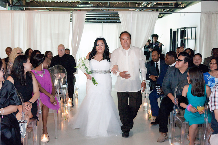 bride down the aisle wedding ceremony at Canvas Event Space