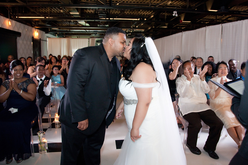 first kiss wedding ceremony at Canvas Event Space