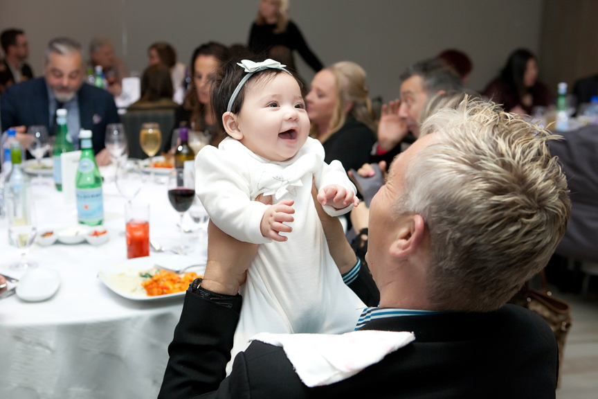 Baptism party at Universal EventSpace happy baby