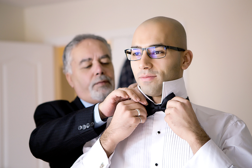 groom prep wedding getting dressed