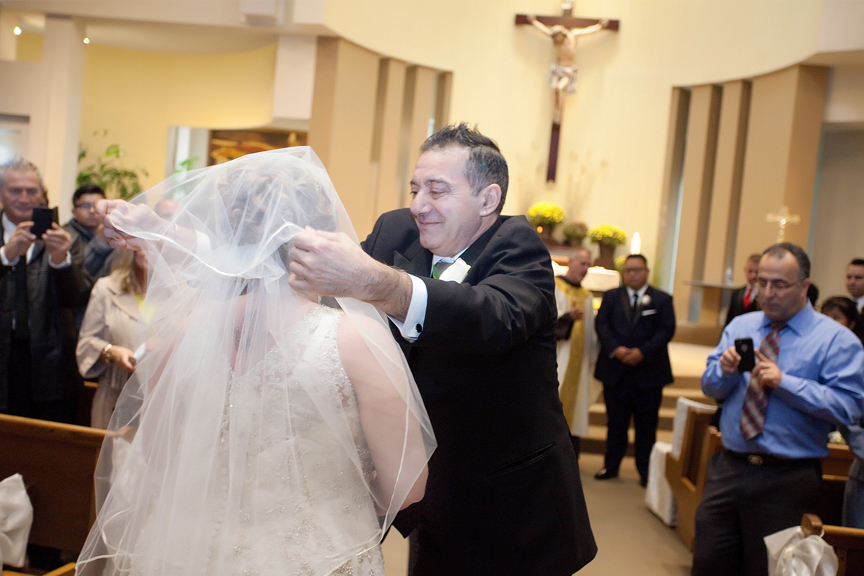 father giving away the bride wedding ceremony at St Peter's Roman Catholic Church
