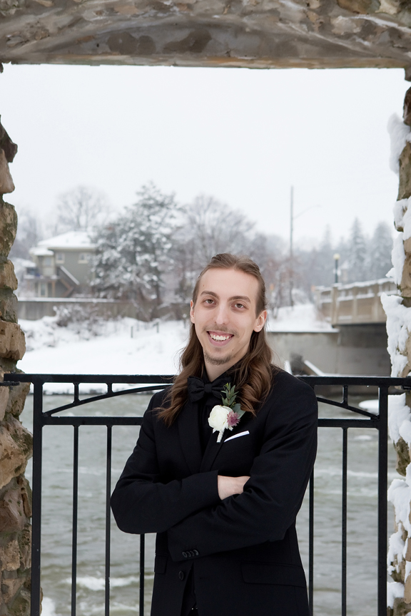 groom winter wedding portrait at Mill Race Park
