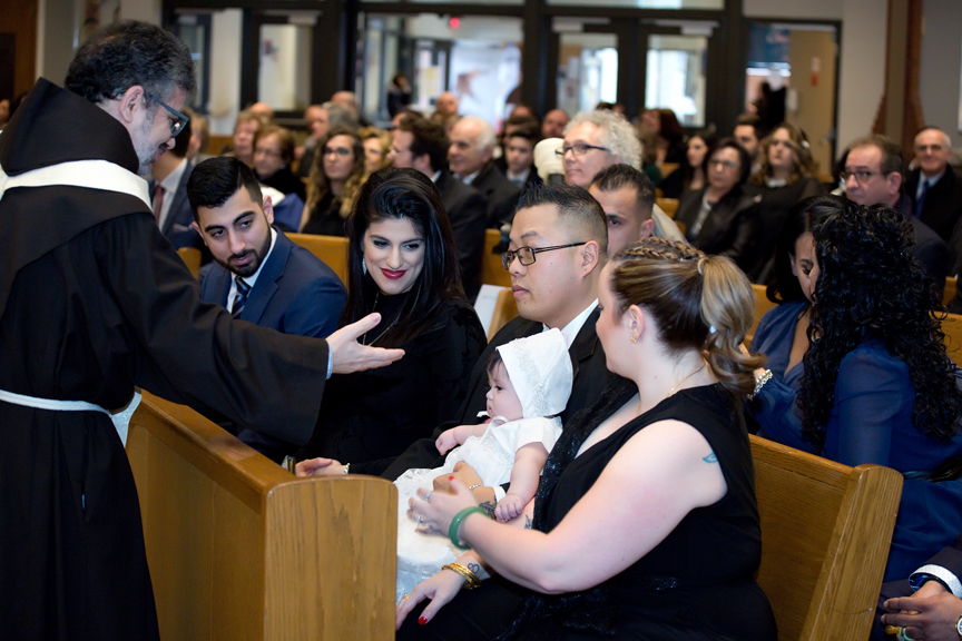 Milestone Event Photography Baptism at St Peter's Roman Catholic Church blessing