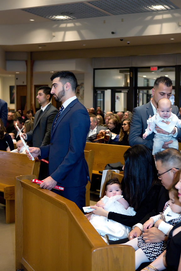 Milestone Event Photography Baptism at St Peter's Roman Catholic Church candle