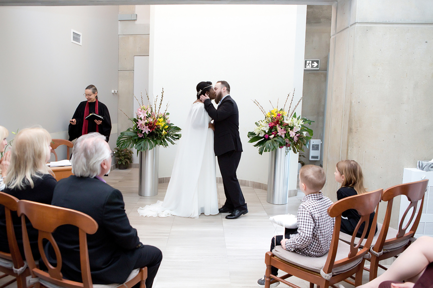 Toronto City Hall wedding ceremony elopement at Toronto City Hall first kiss