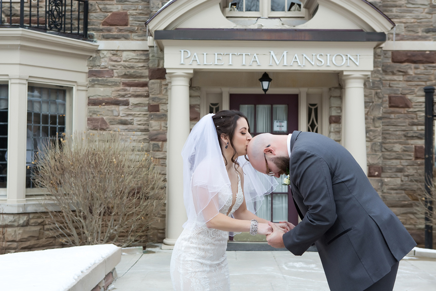 Paletta mansion winter wedding portrait kiss for good luck