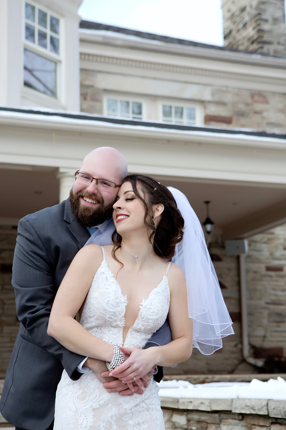 Paletta mansion winter wedding portrait bride and groom snuggle