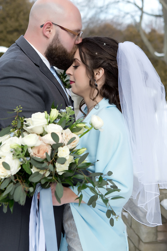 Paletta mansion winter wedding portrait bride and groom kiss on forehead