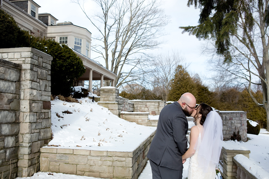Paletta mansion winter wedding portrait bride and groom kissing