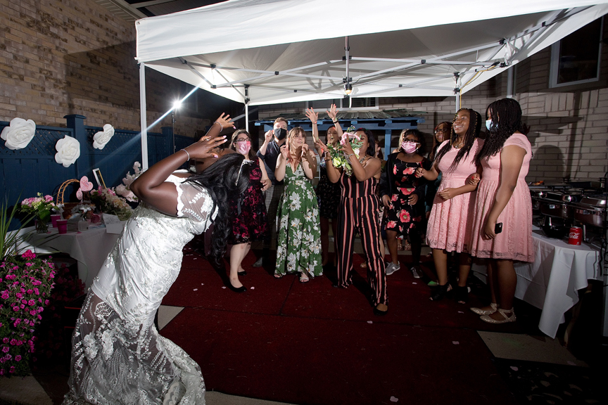 Wedding reception bouquet toss