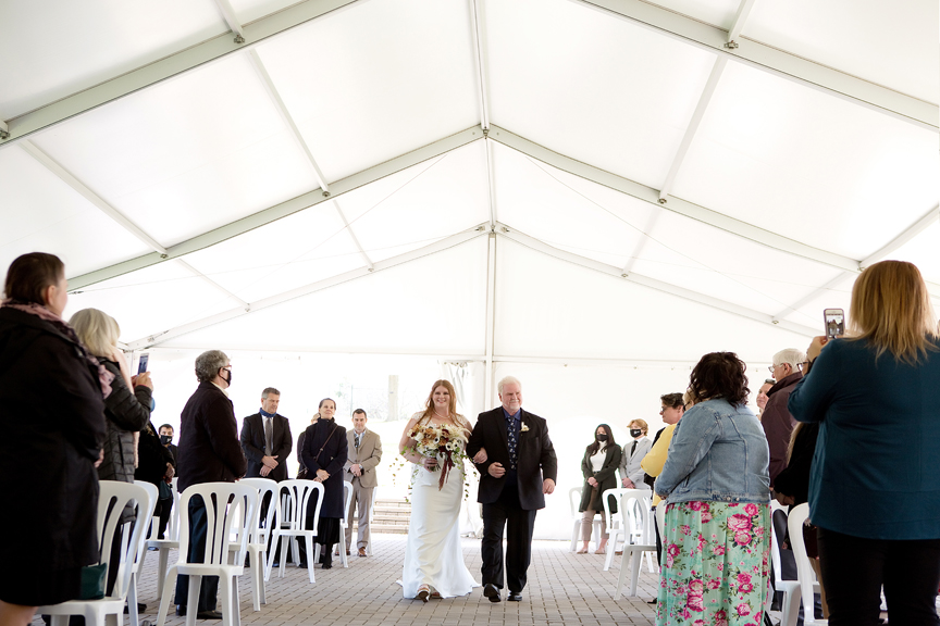 bride down the aisle wedding ceremony at Rose Garden Tent