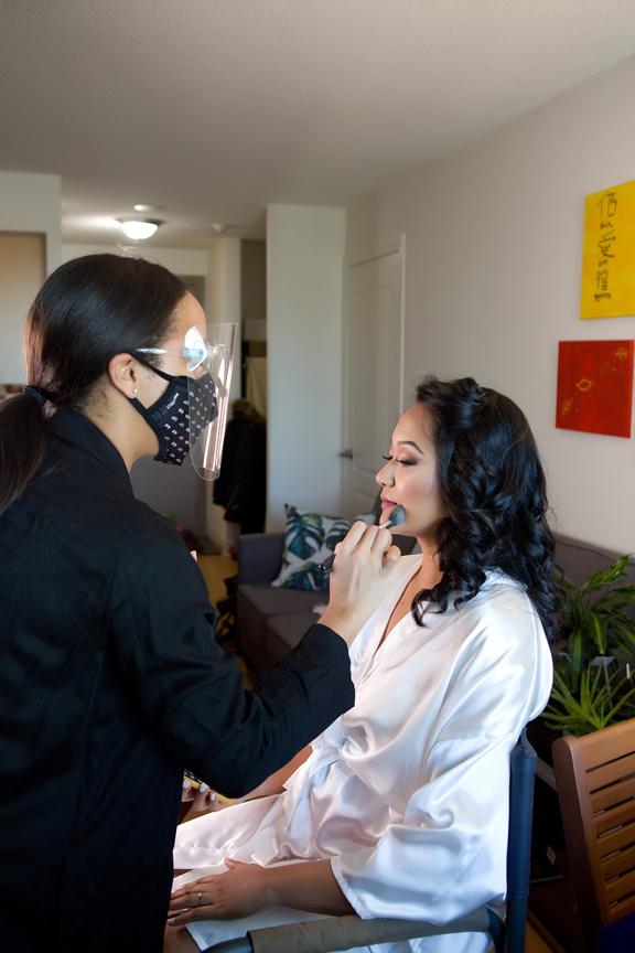 Bride prep makeup during COVID-19