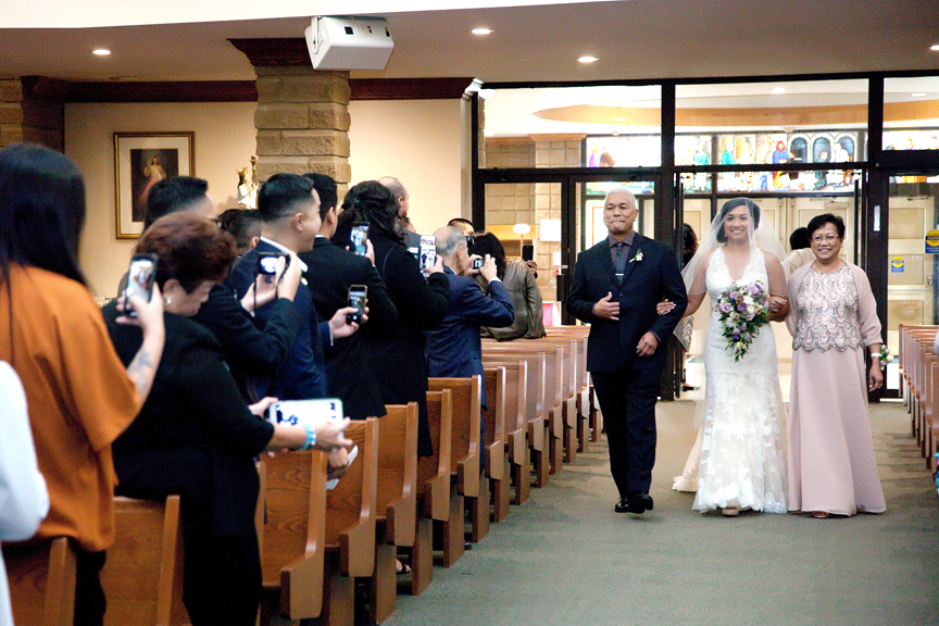 bride down the aisle wedding ceremony at St Isaac Jogues Catholic Church